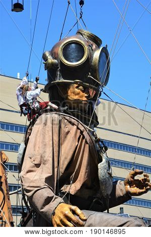MONTREAL QUEBEC CANADA 19 05 17: The giant deep-sea diver sleeping in the street of Montreal for the 375e anniversary of the city, by Royal De Luxe company Nantes France