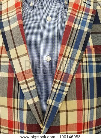 retro plaid suit jacket with blue and white checkered shirt