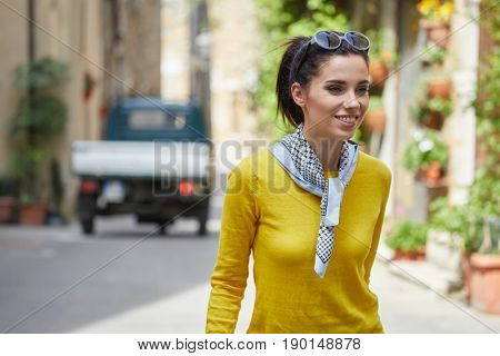 Tourist woman  in a small Italian town