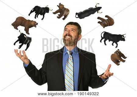 Hispanic mature businessman confidently juggling Stock Market symbols of bears and bulls