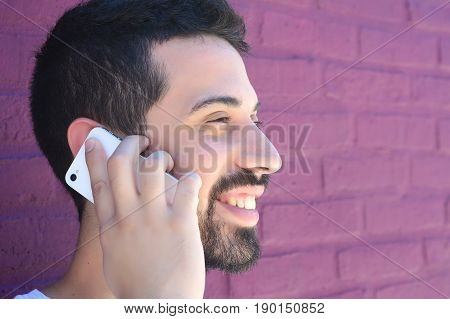 Latin Man Talking On The Phone