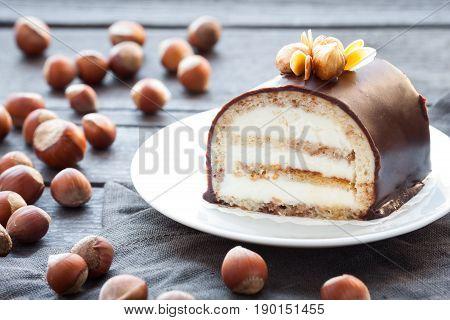 Cake Sour Cream With Whole Hazelnut On A Dark Background