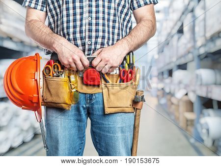portrait of handyman ready to work in warehouse