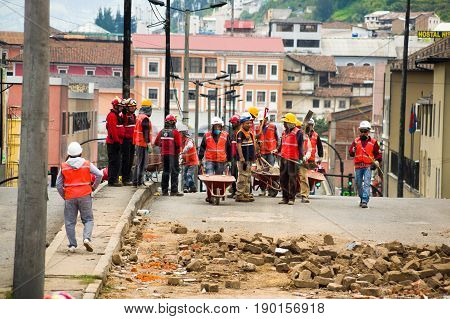 Quito, Ecuador - December 09, 2016: An unidentified group of firemans, with a construction stuffs to clean the damage area and destruction after fire Inferno in buildings.