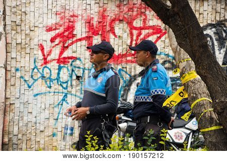 Quito, Ecuador - December 09, 2016: An unidentified police officers on duty in Quito city.