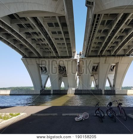 underneath the Wilson bridge in Alexandria Virginia and Potomac river and bikes