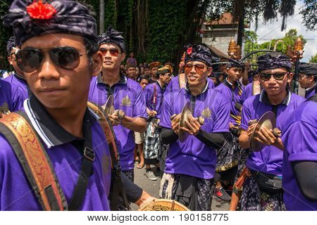 Bali, Indonesia - August 20, 2016: Balinese people participating in royal cremation ceremony in Ubud, Bali.
