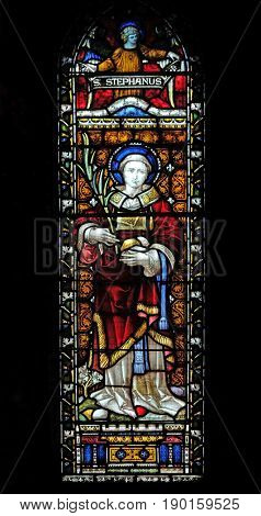 ROME, ITALY - SEPTEMBER 02: Saint Stephen on the stained glass of All Saints' Anglican Church, Rome, Italy on September 02, 2016.