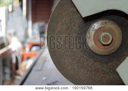 Close up metal cutting abrasive blade on blurred background
