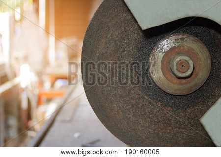 Close up metal cutting abrasive blade on blurred background sunshine effect