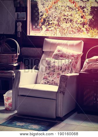 Vintage white old sofa near window in messy living room vintage filter effet.