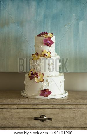 Three tier wedding cake with orchid petals