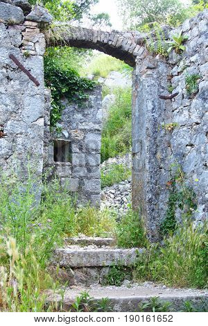 Old stone walls of medieval fortification on Lovcen mountain in Kotor, Montenegro, Europe