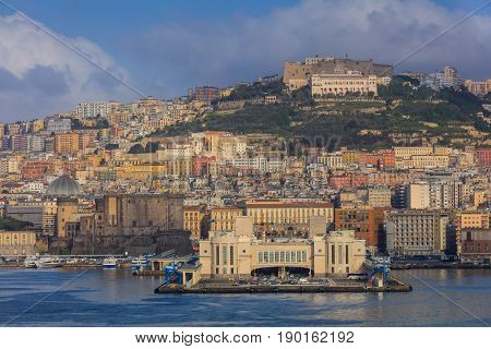 Port of Naples Italy in Europe with buildings in the background.