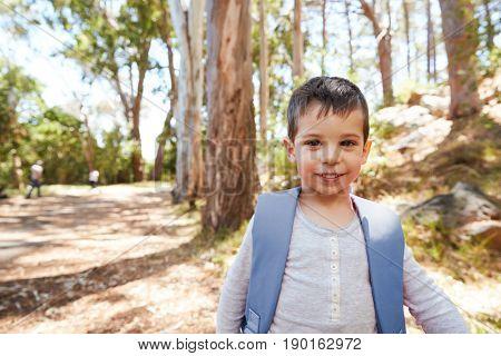 Portrait Of Boy Wearing Backpack On Countryside Walk