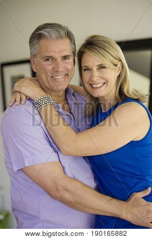 Caucasian couple hugging indoors