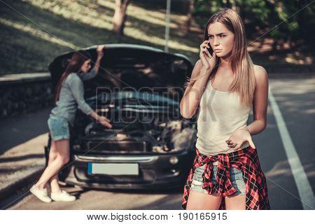 Girls Having Problem With Car