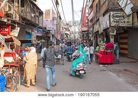 NEW DELHI, INDIA - APRIL 5, 2017: People walking in the streets from New Delhi, India on the 5th of april 2017