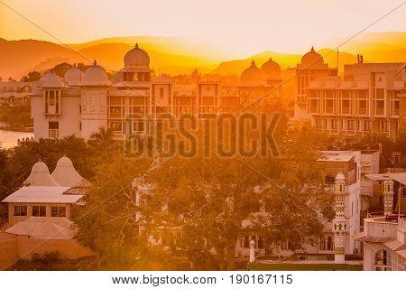 Sunset at lake Pichola and Taj Lake Palace, Udaipur, Rajasthan, India, Asia.
