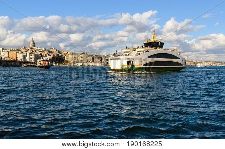 Istanbul Turkey - November 01 2016: Ferry boat in Bosporus. And view of old Istanbul and Galata tower