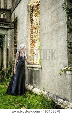 Caucasian woman wearing evening gown in garden