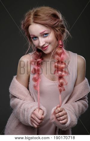 Portrait Of A Girl With Pink Hair In Braids With Blue And Pink Makeup, A Pink Coat, Off The Shoulder