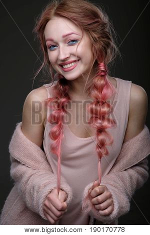 Portrait Of A Girl With Pink Hair In Braids, And Blue And Pink Makeup, A Pink Coat, Worn Off The Sho