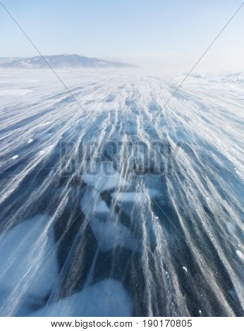 Snowstorm. Ice Of Lake Baikal. Winter Landscape
