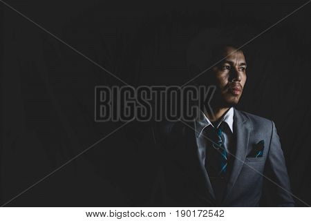 Portrait Of A Depress Business Mature Man Stand In The Dark