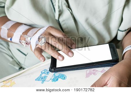 woman in hospital room on bed sick and injured is using mobile phone. blank display for graphic designer