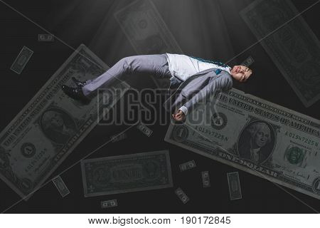 Falling And Screaming Businessman In Formal Wear Bank Note On Black Background(bankrupt Concept)