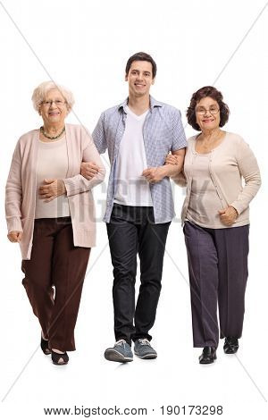 Full length portrait of a young man with two mature women walking towards the camera isolated on white background