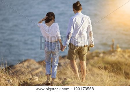 couples of younger man and woman vacation traveling and relaxing sea side