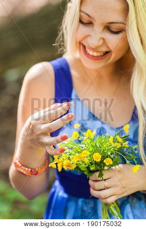 proposal, holidays, jewelry and people concept - close up of happy woman with engagement ring in the park.