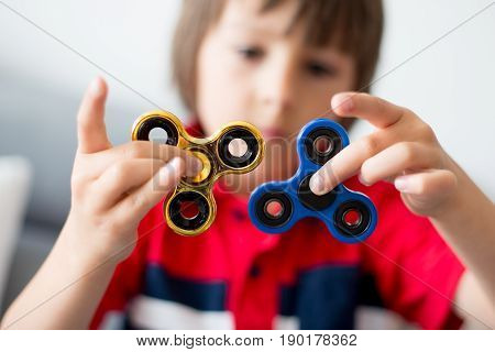 Little Child, Boy, Playing With Two Fidget Spinner Toys