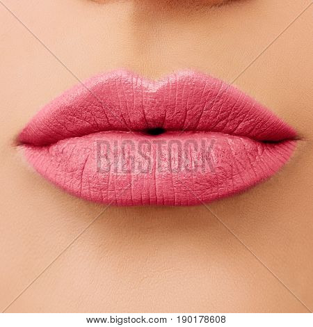 Macro Photo of Rose Female Lips. Pink Lips with Lipstick Makeup Closeup