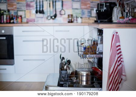 Dishwasher, Filled With Dirty Dishes And Glasses