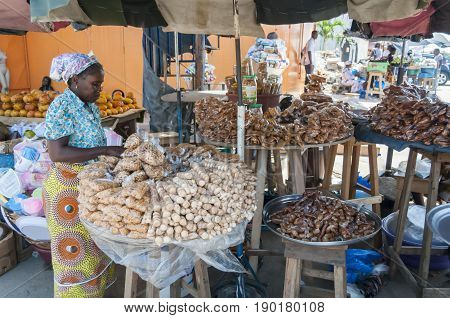 Sweets and nuts sold at the Abidjan market. Abidjan, Ivory Coast, Africa, Circa May 2013.