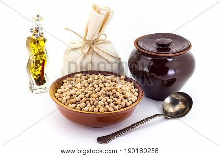 The Composition Of Chick Peas In A Clay Pial Next To A Clay Pot And A Copper Spoon,