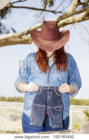 A Pregnant Woman Expecting A Baby Boy In Cowboy Hat