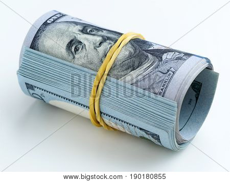 A Bundle Of Money Tied With A Rubber Band