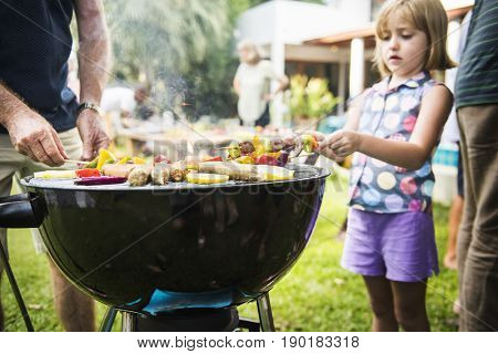 Family spending time together with barbecue party in the yard