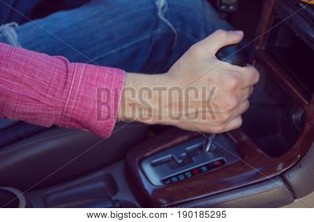 Man Driving A Car. Hands On The Transmission