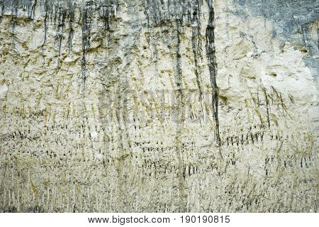 Old masonry made of limestone mine. Limestone is stratified of atmospheric influences and age. Background texture