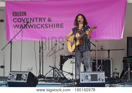 COVENTRY, UK - JUNE 4: Singer Mellow Baku gives a public performance to the passing shoppers in Coventrys city centre as part of the MotoFest weekend event on June 4, 2017 in Coventry
