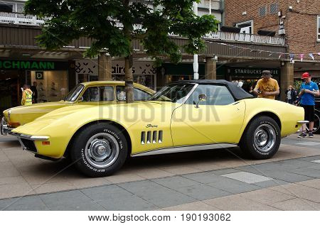 COVENTRY, UK - JUNE 4: A vintage Corvette sports car stands on public display in the centre of Coventrys shopping area as part of the MotoFest weekend event on June 4, 2017 in Coventry