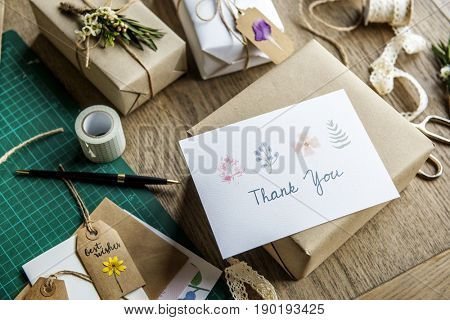 Thank You Card with Wrapped Craft Paper Gift Box Background