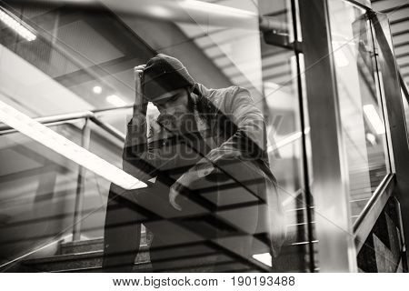Adult Man Sitting Look Worried on The Stairway