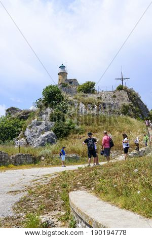 KERKYRA, GREECE - MAY 23: Tourists on their way to the lighthouse on the old Byzantine fortress on May 23, 2017 in Kerkyra, Corfu island in Greece.