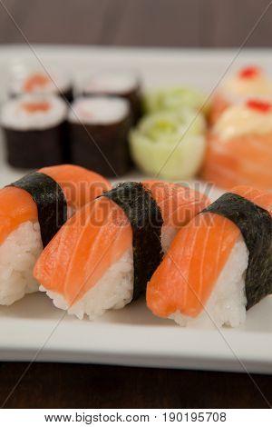 Close-up of three nigiri sushi served in white plate